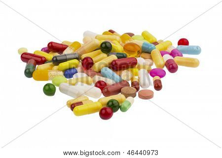 many colorful pills on a white background. symbolic photo for medicine and drugs