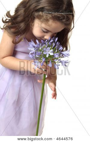 Girl Smelling A Beutiful Flower