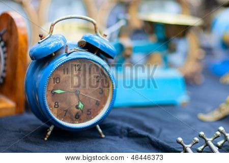 Vintage blue alarm clock at flea market
