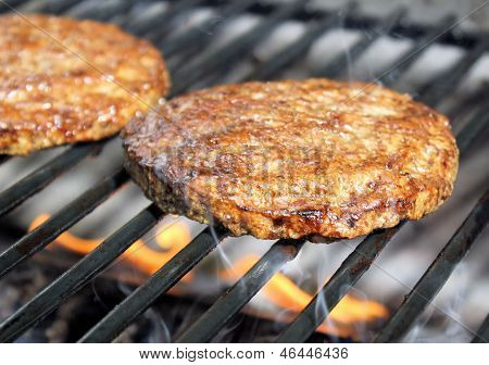 Burgers Sizzling On The Grill