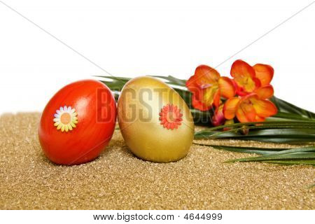 Easter Red And Golden Decorated Eggs With Freesia Flower