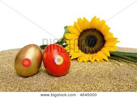 Easter Red And Golden Decorated Eggs With Sunflower On White