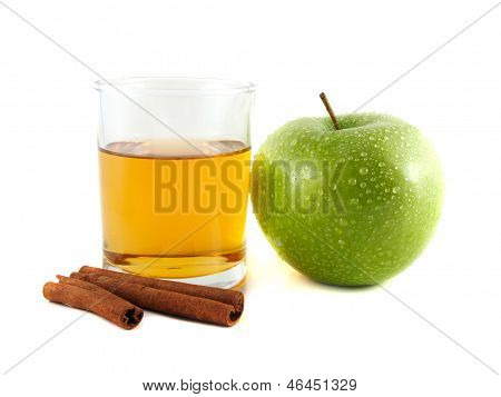 Green Apple And Glass Of Juice With Cinnamon