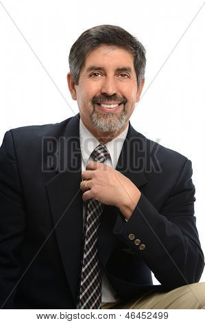 Portrait of Hispanic businessman smiling isolated over white background