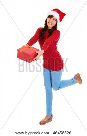 Giving Christmas gift. Young Asian Santa girl deliver a Christmas present. Full body isolated on white background.