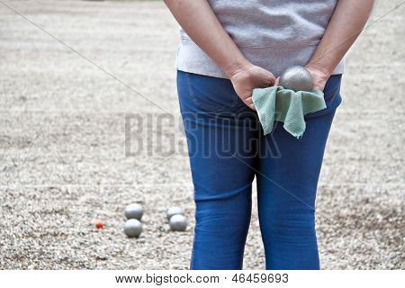Woman with boule balls during a game