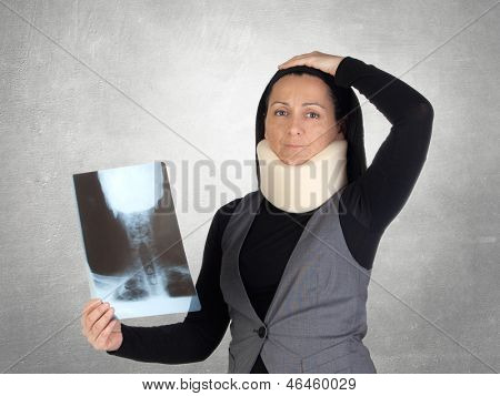 Concerned woman with cervical collar and radiography on a gray background