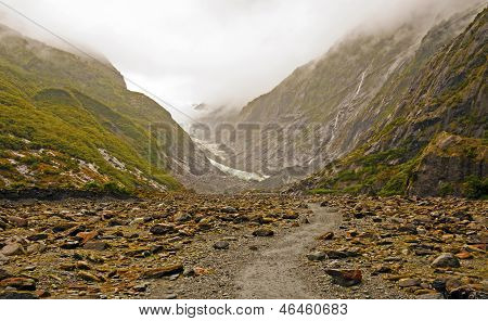Alpine Glacier In The Clouds And Fog