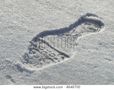 Woman's Shoe Footprint In The Snow