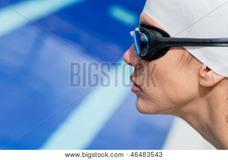 Portrait of a professional female swimmer by the pool