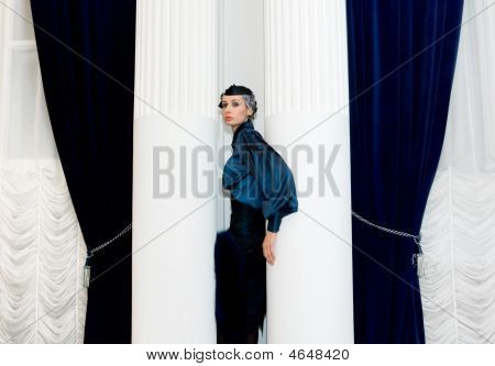 Girl Between Two Columns