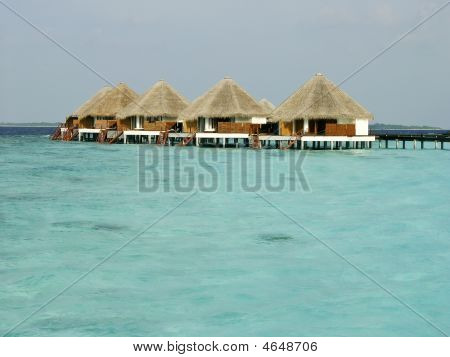 Tropical Beach And Cabanas On Maldives Island