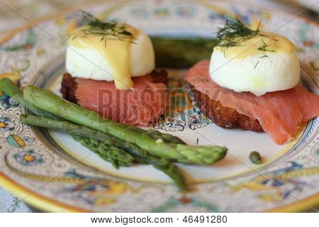 Eggs Benedict side view with asparagus
