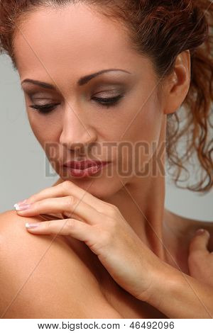 Portrait of beautiful middleaged woman in towel