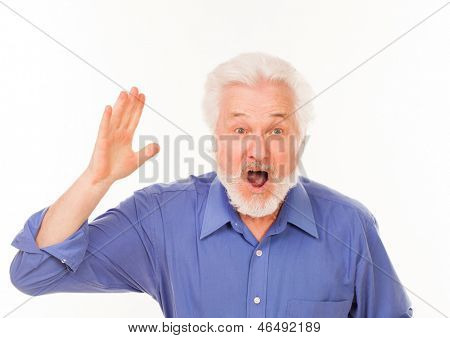 Handsome elderly man with gray beard shouting isolated over white background