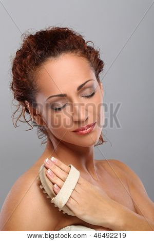 Beautiful middleaged caucasian woman massages herself