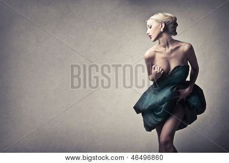 beautiful blonde woman wearing elegant dress