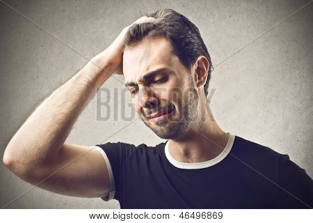 desperate man with hand in hair