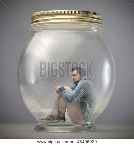 young man imprisoned in a jar