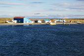 image of tierra  - Huts on the shore of Tierra del Fuego - JPG