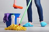 stock photo of legs apart  - Cleaning floor in room close - JPG