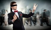 foto of blindfolded man  - young blindfolded man - JPG