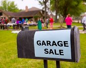 Garage sale in an american weekend on the yard green lawn