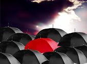 stock photo of safe haven  - illustration image of multiple umbrella with single red umbrella - JPG