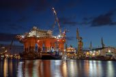 stock photo of shipyard  - Repair of the oil rig in the shipyard - JPG