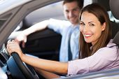 stock photo of car-window  - Young couple sitting in car - JPG