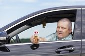 stock photo of pedophile  - Man sitting in a car offers ice cream - JPG