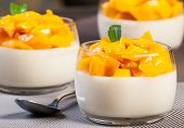 stock photo of panna  - sweet mangoes combined with coconut panna cotta - JPG