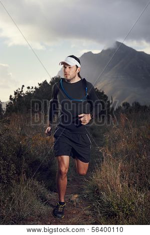 Ultra marathon trail runner with determintion exercising for fitness and healthy lifestyle