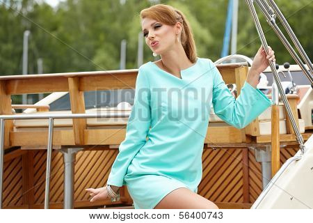Elegant retro woman wear dress ,  near the yacht marine. 60's inspiration