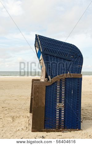Typical blue chair at the beach of German wadden island Borkum