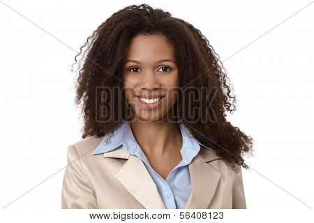 Close-up portrait of beautiful afro-american businesswoman smiling.