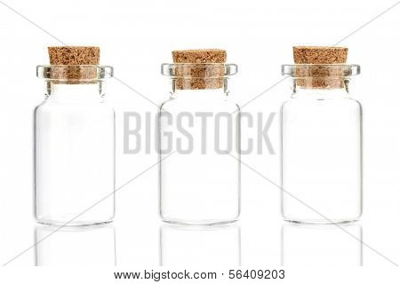 Empty little bottles with cork stopper isolated on white
