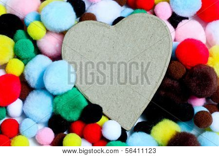 Miuticolored pom-poms with paper heart