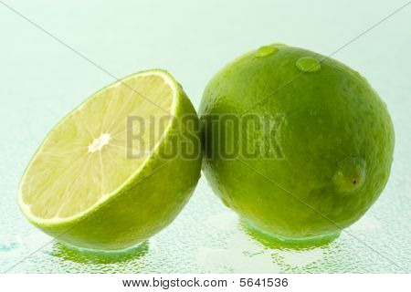 Lime And Its Half With Water Drops