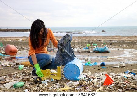 Trying To Pick Up Plastic In The Middle Of Pollution