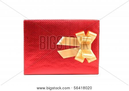 Red present box with asterisks and golden bow.