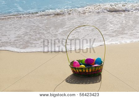 Easter Basket With Eggs On The Beach