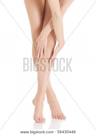 Smooth, shaved woman's legs. Isolated on white.