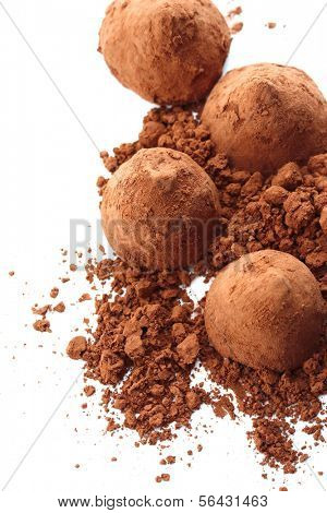 Chocolate truffles and cocoa, isolated on white