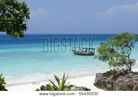 Wooden boat on turquoise water in Zanzibar, Tanzania, Africa