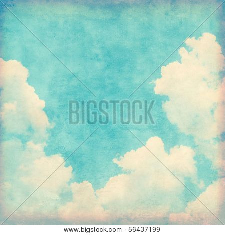 Blue sky with clouds in grunge style.