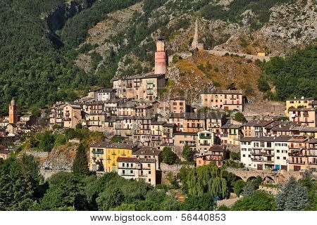 View of small town of Tende on the slopes of mountains in Alps, France.