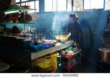 Vietnamese Chef  Broit Meat At Com Tam Reataurant
