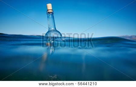 Bottle with a message in water