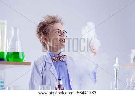 Funny boy watching reagent evaporation, close-up